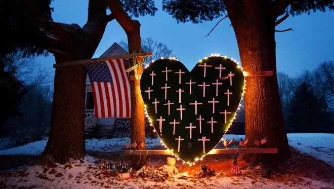 A makeshift memorial with crosses for the victims of the Sandy Hook massacre stands outside a home in Newtown, Conn., on Dec. 14.