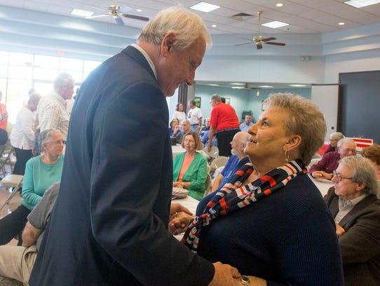 Senator Jim Mathias greets supporter Arlene Page during