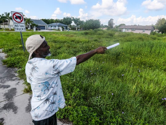 George Cole, a long time Dunbar resident, points to one of many locations in his neighborhood where a pond used to be. The Department of Environmental Protection staff had their ground-penetrating radar out scanning residential land Thursday morning for signs of house the ponds may have been filled in.