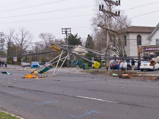 A vehicle toppled a traffic light and utility pole