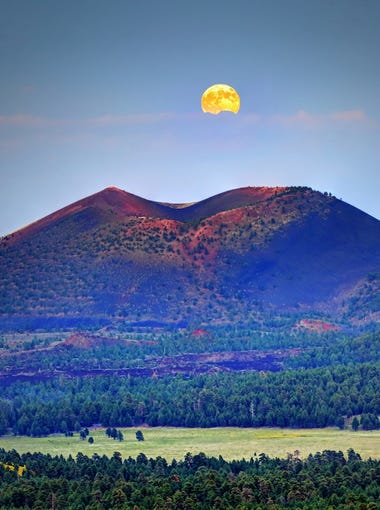 "A photo-worthy moment: The full moon rising over Sunset Crater near Flagstaff. Andrei Stoica of Chandler tagged his photo on Instagram ""#supersized."" See more of his photos at instagram.com/astoica."