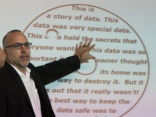 CPR Tools Inc. CEO John Benkert points to his presentation slide during the Data Privacy and Cyber Liability conference as a part of the Identity Fraud Institute at Hodges University on Wednesday, Sept. 21, 2016. The mission of the Identity Fraud Institute is to learn, share and collaborate through educational opportunities for the community and professionals in Lee and Collier counties.