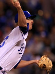 Kansas City Royals relief pitcher Alec Mills delivers
