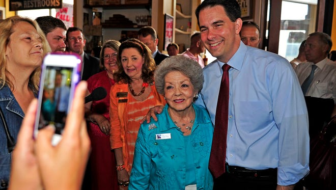 Republican presidential candidate Wisconsin Gov. Scott Walker, right, poses for a photograph with Bobbie Patray at Puckett's Grocery and Restaurant in downtown Nashville, Tenn., Wednesday, July 22, 2015.