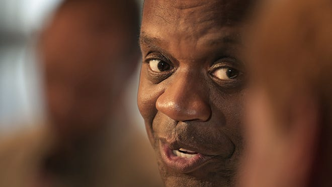 Detroit emergency manager Kevyn Orr talks to reporters after signing Order #42, giving all authority back to Detroit Mayor Mike Duggan and the Detroit City Council in his office at the Coleman A. Young Municipal Building in Detroit on Thursday.