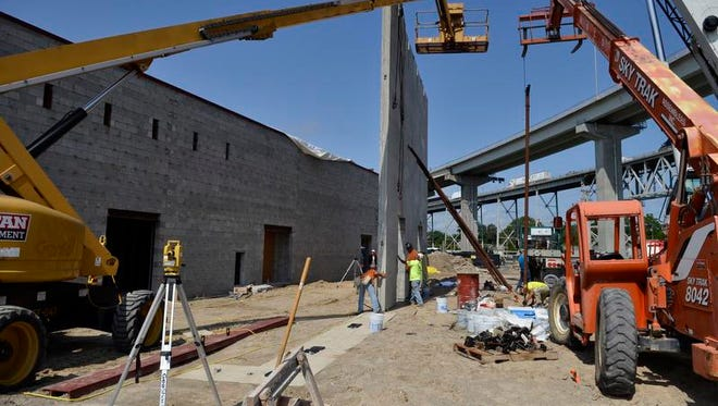 Workers place the walls of the St. Clair County Convention Center Thursday, Aug. 21 next to the Doubletree by Hilton in Port Huron.