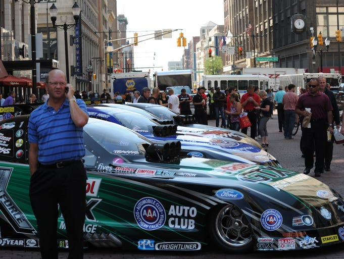 Funny Cars on display on  the south segment of the circle during the Fan Fest for the  NHRA US Nationals on Monument Circle  Wednesday, Aug. 27, 2014. in downtown Indianapolis.