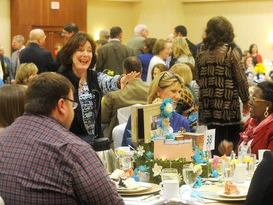 People visit during the annual Women of Outstanding