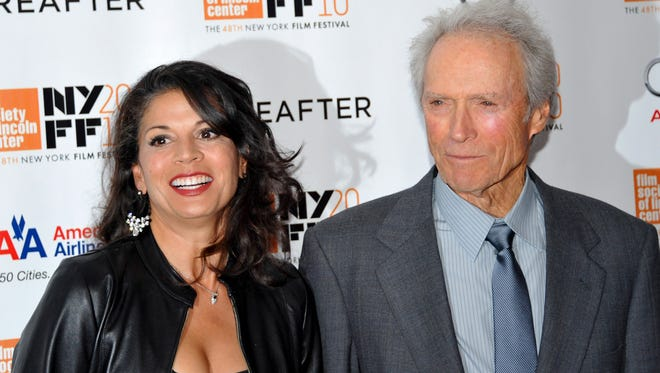 Clint Eastwood and second wife Dina Marie Eastwood in 2010. The couple's divorce was finalized Dec. 23, 2014.