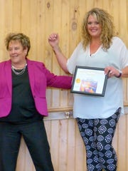 The positive attitude of Parks and Recreation administrative assistant Melissa Haynes, at right, makes everyone around her happy, Village Manager Debi Lee said.