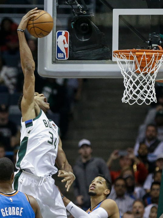 Milwaukee Bucks' Giannis Antetokounmpo way up for a dunk against Oklahoma City Thunder during the first half of an NBA basketball game Tuesday, Oct. 31, 2017, in Milwaukee. (AP Photo/Tom Lynn)