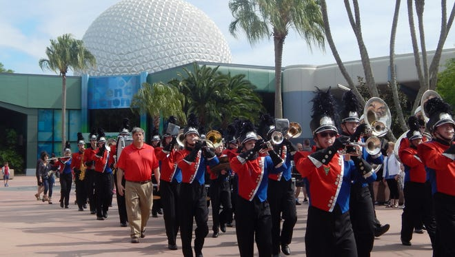 """Members of Conner High School """"Marching Cougars"""" performed on March 15, 2015, at the Epcot Park. The group traveled from Hebron, Ky. to the Walt Disney World Resort in Florida to take part in the Disney Performing Arts Program."""