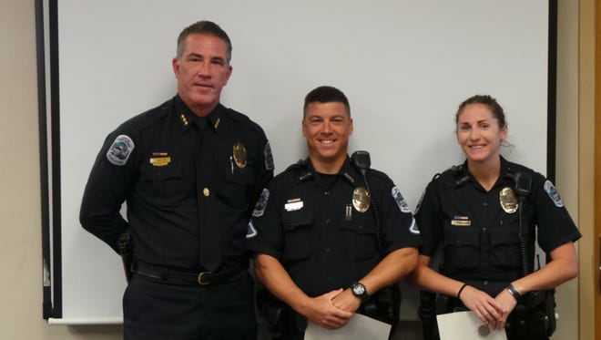 Fort Myers Police Chief Doug Baker with Officer David Conticelli and Officer Kelsey Evenson.