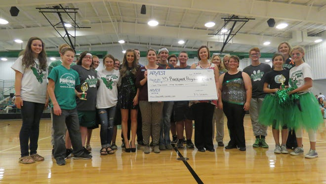 Yellville-Summit School students are shown with a $2,500 donation to the Arvest Bank's 1 Million Meals outreach to fight area hunger.