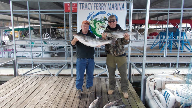 Shown are two of Reynolds' customers, Jay and Doug, with their catch.