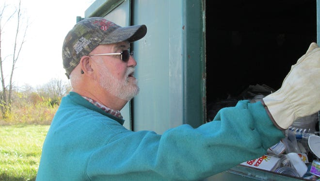 Cecil Dake works Thursday at the Union County transfer station.