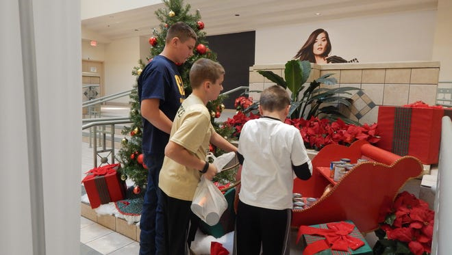"""Canned goods, non-perishable food items are the focus of The Forest Mall's Center Court """"Fill the Sleigh"""" food drive, which will run until Dec. 31."""