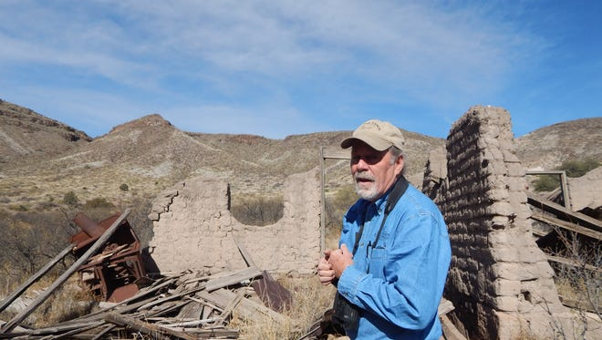 Ted Turner Expeditions guide Ken Stinnett shows visitors adobe remains of the Padilla homestead, dating from the late 1880s, on the Ladder Ranch.