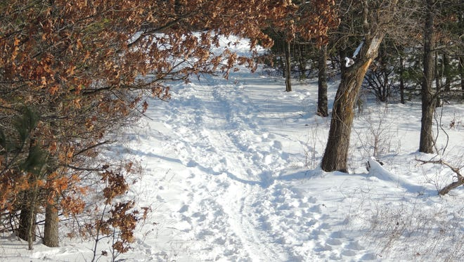 Hartman Creek State Park offers an extensive network of snowshoe trails through the hills and valleys that surround its pristine lakes near Waupaca.