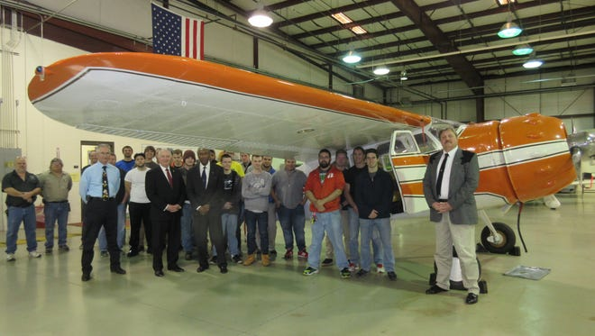 Captain William Wilkerson, center donated a 1952 Cessna 195 aircraft to the Aircraft Maintenance Technology program at Greenville Technical College.