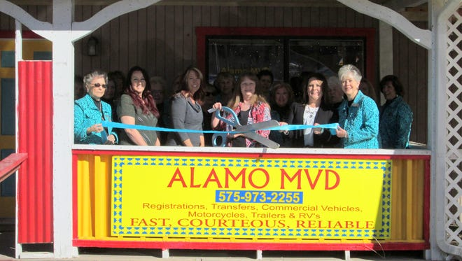 Employees of Alamo MVD celebrated its grand opening at a ribbon cutting ceremony with the Ruidoso Valley Chamber of Commerce Greeters Thursday.