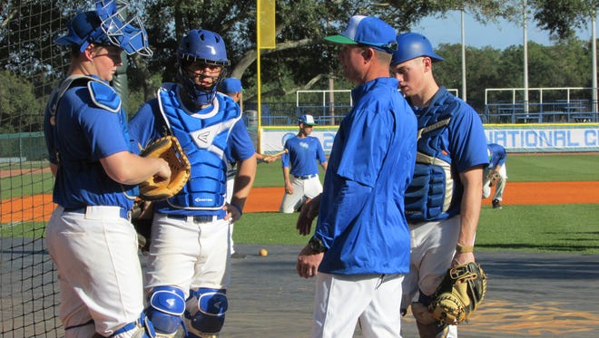UWF baseball coach Mike Jeffcoat, shown earlier this season conversing with his catchers at practice, has led the Argos to their fifth GSC regular-season title and first time hosts of GSC Tournament that begins Saturday. .