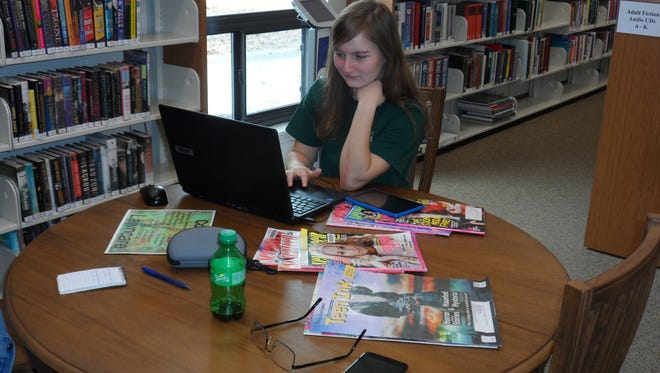 Dakota Ivey, who is home-schooled, works on a computer at the J.L. Robertson Library Branch in Tioga on Monday. The library reopened Monday following a renovation and expansion project.
