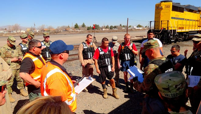 Pictured is a group of first responders from various agencies around the state as they hold a briefing before a mock train derailment training.