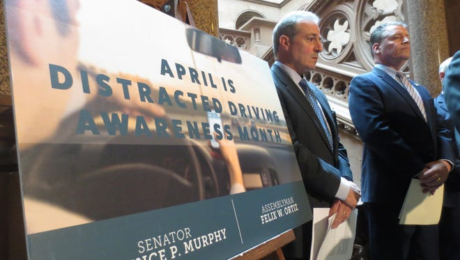 Ben Lieberman, whose son was killed in car in 2011, attends a new conference at the state Capitol on April 5, 2016, with Sen. Terrence Murphy