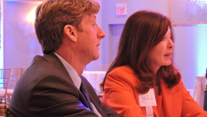 Former U.S. Rep. Patrick J. Kennedy (D-R.I.)  and Adrienne Kirby, president and CEO of Cooper University Health Care discuss efforts by five health systems to reform mental health care delivery in South Jersey at Lucien's Manor in Berlin on Monday.