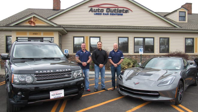 Auto Outlet general manager Kevin Caruso, CEO John Iannone and vice president Eric Miltsch in front Auto Outlets in Farmington, Ontario County.