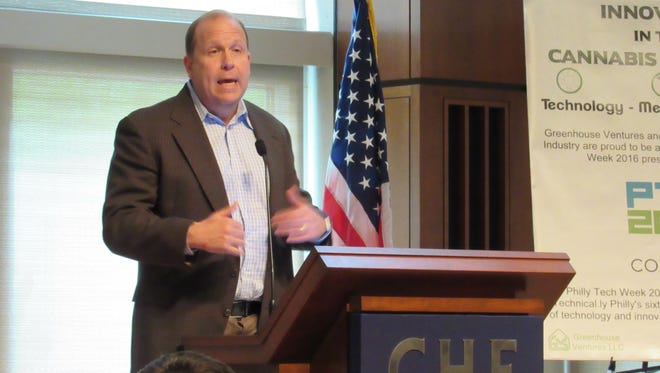 """State Sen. Daylin Leach speaks to the audience at the """"Innovation in the Cannabis Industry"""" conference on Saturday, April 30 in Philadelphia. (Photo by David Weissman)"""