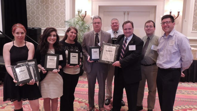The Advocate staff won first place for general excellence in the APME annual contest Sunday for a second consecutive year. Left to right, Jessica Phelps, Emily Maddern, Anna Jeffries, Kent Mallett, Dave Weidig, Michael Shearer, Ryan Cook and Ben Lanka.