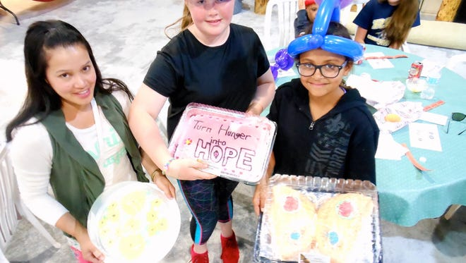 Balloon heads and cakes were a common sight at the May 20 Turn hunger into HOPE event at Church of the Nazarene, Angus.