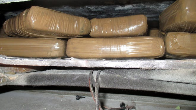 U.S. Customs and Border Protection agents working the Santa Teresa, NM port of entry, found 323.5 pounds of marijuana concealed in a ceiling compartment of a van.