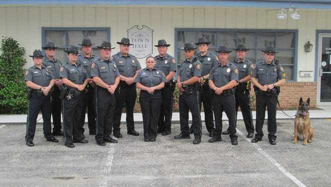 Princess Anne police pose in their new uniforms. The new uniforms were introduced in June 2016 and were paid with seized drug money.
