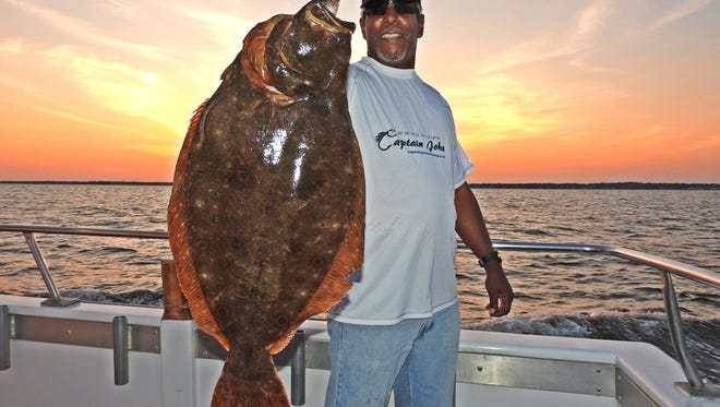 Gary Thompson, Keyport, with a 15-pound, 3-ounce  fluke caught on The Captain John.