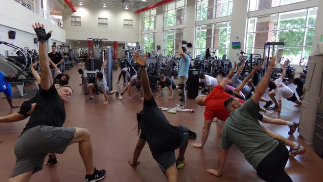 Warm up exercises, led by Sara Kluttz, owner of Prime Fitness Clarksville, helped get everyone prepare for their work-out.All Rise for Exercise
