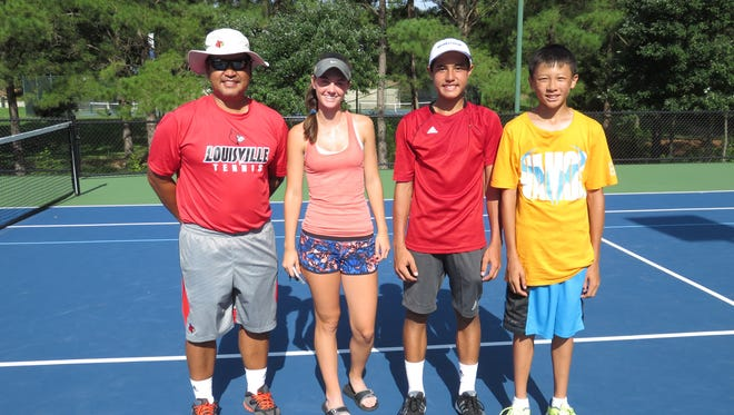 Coach Rex Ecarma, from left, Lauren Waddles, Xavier Ecarma and Michael Chou wee the first Southern team to win  the national boys and girls 14-and-under zonal championships.