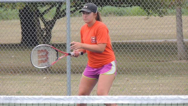 Bucyrus senior Loarel Mollenkopf returns a serve during Thursday mornings open courts at the Bucyrus Community Tennis Courts.