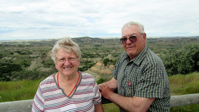 Susan and Bob Manzke take in the scenery of the Painted Desert in North Dakota on a windy day.