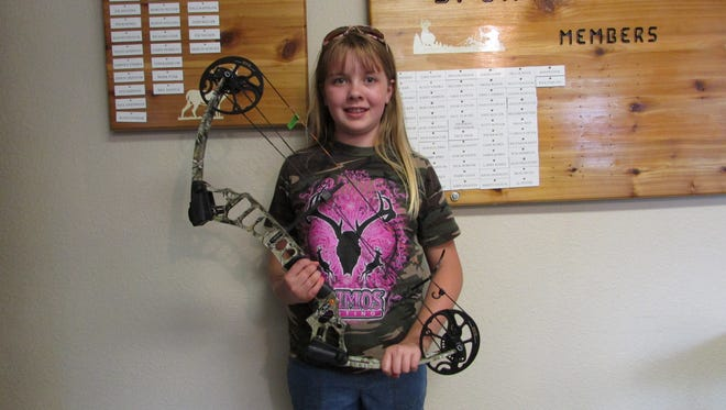 Alyssa Pritchard of Mishicot shows the youth CRAZE bow she won during Mishicot Sportsmen's Club's archery tournament. This was in a special raffle for youngsters only.