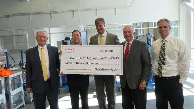 Left to right, Les Gardner of the Greenville Tech Foundation; Mike McCormick, Technical Plant Manager for Bosch Rexroth; Claude Bray, Director of Human Resources for Bosch Rexroth; Dr. Keith Miller, President of Greenville Technical College; and David Clayton, Executive Director for the Center for Manufacturing Innovation are pictured as the company presents a check for $70,000 to the Greenville Tech Foundation to fund scholarships for students in the Manufacturing Honors College at the  Center for Manufacturing Innovation.