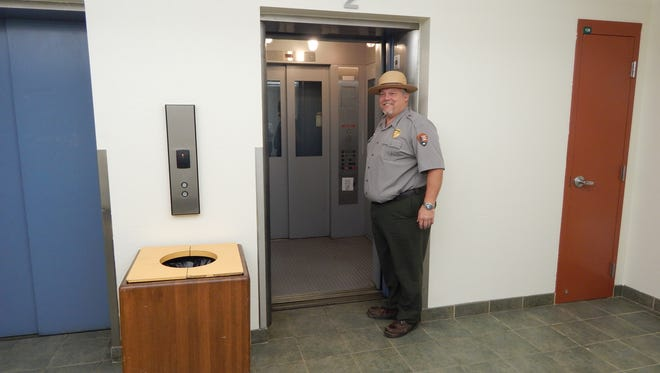 Carlsbad Caverns National Park Superintendent Doug Neighbor standing outside of one of the secondary elevators.