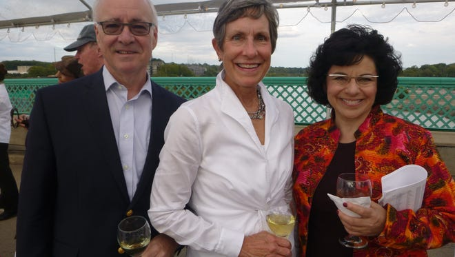 Jeff and Lyn Johnson with Arts & Culture Alliance's Executive Directo, Liza Zenni on the Gay Street Bridge.