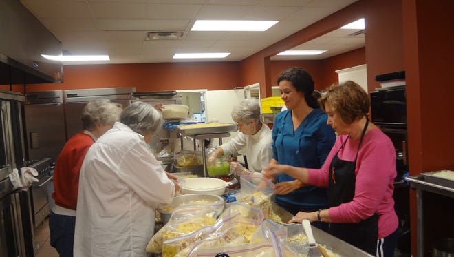 Peggy Carpenter, Evelyn Wesley, Becky Shelton, Christy Dickerson and Gloria Bynum bag cornbread for one of Oak Grove UMC's annual Thanksgiving Dinner.