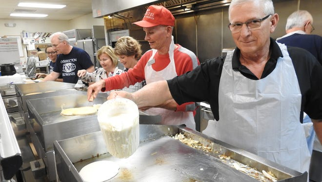 Local leaders prepared pancakes Thursday during the Coshocton Kiwanis Club's 75th Annual Pancake Day at the Elks' Lodge. From right are County Commissioner Dane Shryock, County Engineer Fred Wachtel, City Auditor Sherry Kirkpatrick, Coshocton County Chamber of Commerce Executive Director Amy Stockdale, Kiwanian Craig Patterson and Kiwanis Past President Tabitha Patterson.
