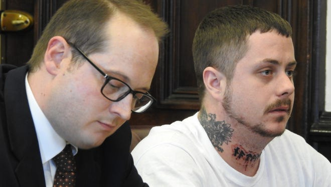 Richard Kafel, right, of Coshocton, will serve four years in prison on an aggravated burglary conviction. Authorities say Kafel was shot twice by a resident during that break-in on Aug. 18. He appeared for sentencing Thursday in Coshocton County Common Pleas Court, represented by attorney Frederick Sealover, left.
