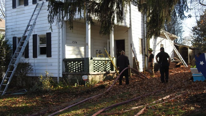 Jeremiah Norman and Zarek Morgan were playing video games Thursday when they heard a smoke alarm. The two jumped from a second-story window and then re-entered the home to save a dog.