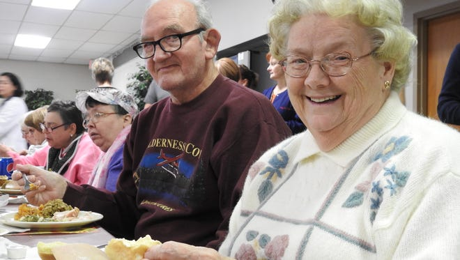 Frances and Ellsworth Richcreek, from right, enjoyed a Thanksgiving luncheon Tuesday at the Coshocton Senior Center, along with hundreds of other seniors.